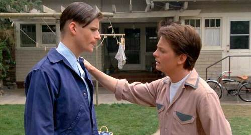 Marty McFly (Michael J. Fox) gives his father (Crispin Glover) tips on how to pick up his Mom.