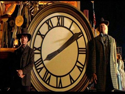 A poignant moment in Back to the Future Part III with Marty and Doc posing for a picture in front of a clock that will go on to have a great meaning for the two.